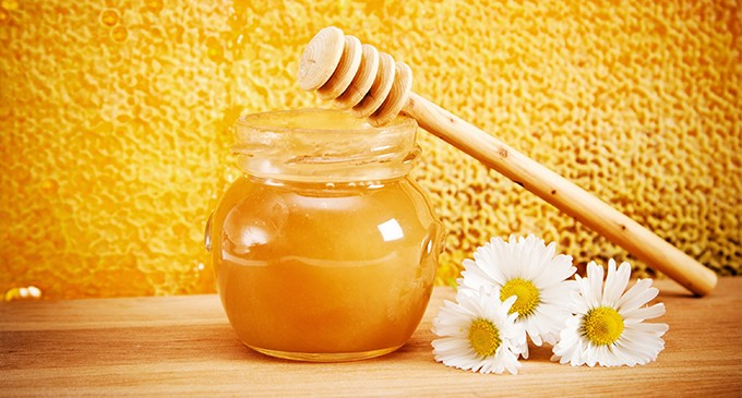 tarro de miel con flores