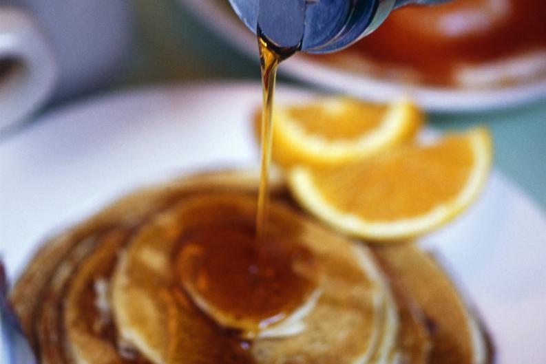 jarabe de miel de naranjas en waffles
